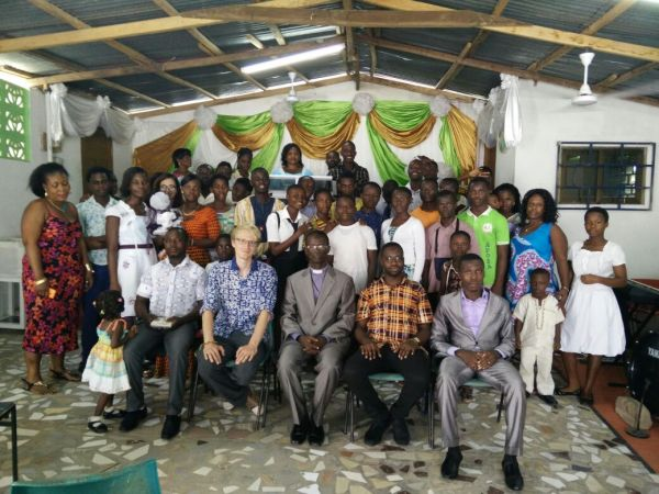 The Whole Team at the Church in a Group Photo with a Section of the Church Congregation