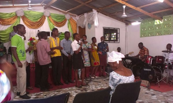 Participants and Team Leaders Ministering a Song at Church